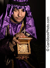 Magi with a golden box filled with Frankincense. Frankincense is the hardened resin of the Boswellia tree. This is frankincense from Omani which is said to be the best in the world. Has a beautiful spicy warm citrusy long lasting aroma. Focus to frankincense resin only.