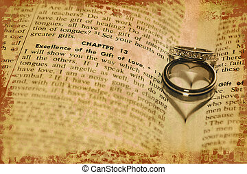 Gift of Love - The shadows of of two wedding rings form...