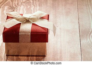 Gift on brown wooden floor