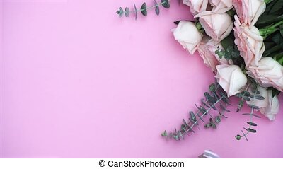 gift or present box and flowers - hands placing gift or...
