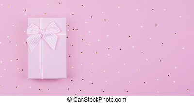 Gift or present box and stars confetti on pink background. Flat lay composition for birthday New Year, copy spase