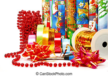 Gift packaging - scissors, ribbons, bows, paper