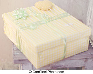 Gift packed in a yellow box a rustic style