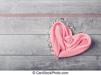 Gift pink silk scarf in the form of heart