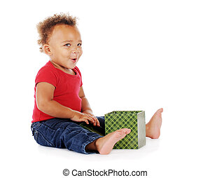 Gift Pleasure - An adorable biracial baby looking up with ...