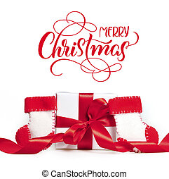 Gift red ribbons and boots of Santa Claus with text Merry Christmas. Lettering calligraphy