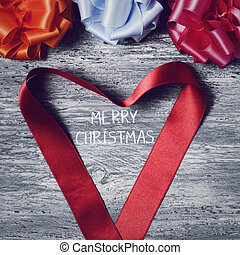 gift ribbon bows and text merry christmas