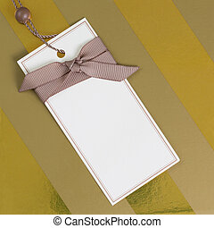 a blank gift label on a gold box