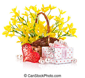 gift with red heart and yellow flowers in basket