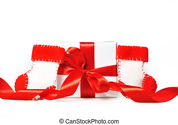 Gift with red ribbons and boots of Santa Claus