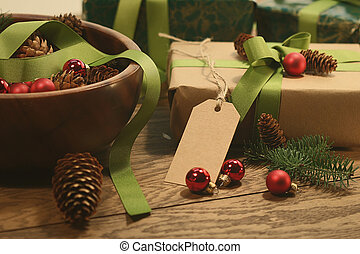 Gift with tag for the holidays on wood table