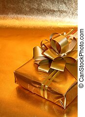Gift Wrapped - A box with gold matching bow on matching ...