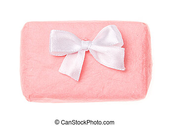 Gift wrapped in pink paper close up.