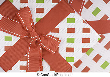 gift wrapping with a red bow