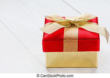 Giftbox on white wooden background