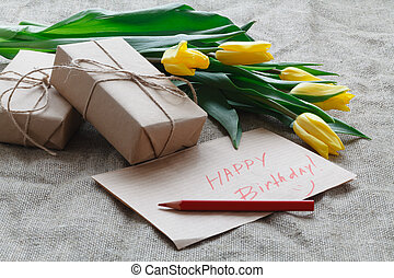 giftbox with bouquet of yellow tulips
