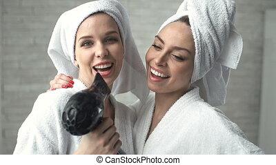 Gifted Singers - Two ladies in bathrobes singing songs and...