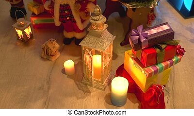 Gifts and candles under Christmas tree. Christmas and New...