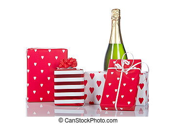 Gifts and champagne bottle - Assortment of gifts and...