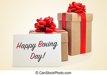 some gifts tied with red ribbon and a signboard with the text happy boxing day, on a beige background