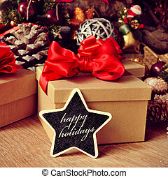 gifts and text happy holidays in a star-shaped chalkboard -...