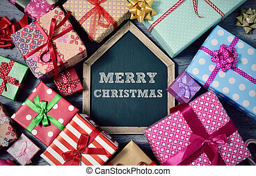 gifts and text merry christmas in chalkboard
