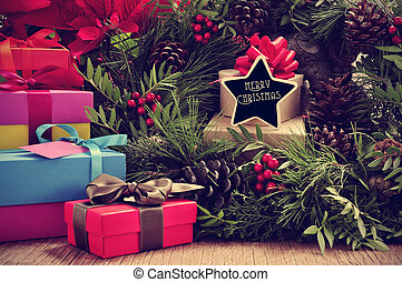 gifts, christmas wreath and text merry christmas in a...