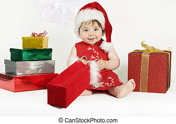Gifts for Baby - A baby wearing a red dress and hat sits...