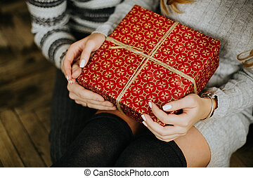 gifts for the new year in the hands of a family holiday