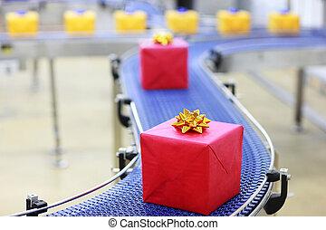 Gifts on conveyor belt - Gifts on conveyor belt in Christmas...