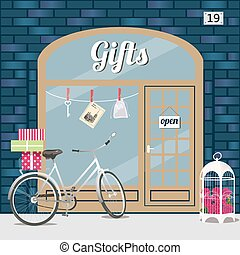 Gifts shop. - Gifts shop s facade of blue brick. Bike with...