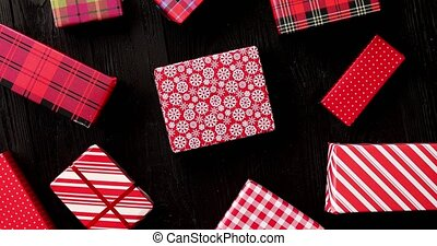 Gifts wrapped in festive paper - From above view of wrapped...