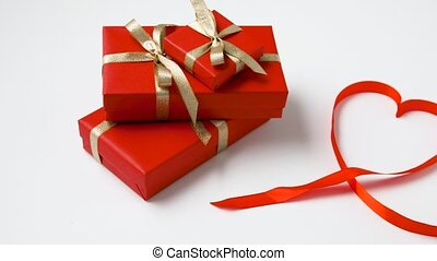 gifts wrapping into red paper for valentines day -...