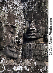 Gigantic face statues at the richly decorated 12th century Khmer ruin of the Bayon, built by Javayaram VII and standing at the center of Angkor Thom. The faces are thougt to represent Bodhisattva Avolokiteshvara. Angkor Wat ruins near Siem Reap, Cambodia