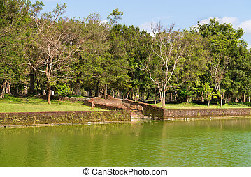 Gigantic man made pond in tropical forest - Steps to...