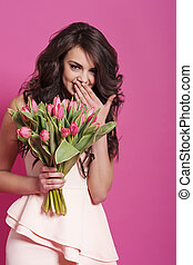 Giggle beautiful woman with freshness flowers