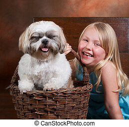 Giggling doggy - Little blond girl and her dog, both with a...