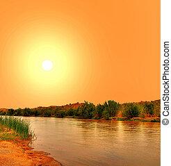 Gila River in Arizona with yellow sunset