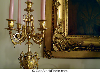 Gilded antique candelabra and picture frame corner