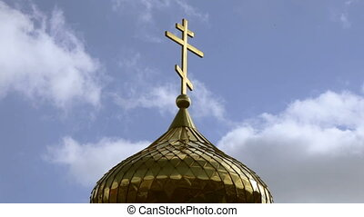 Gilded dome orthodox church . Full hd video - Church cross...