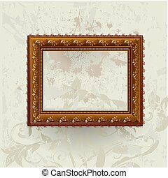 Gilded frame on grunge wall