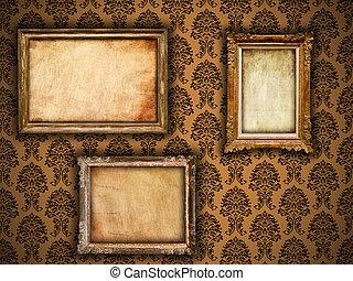 Gilded frames on vintage damask style wallpaper background...