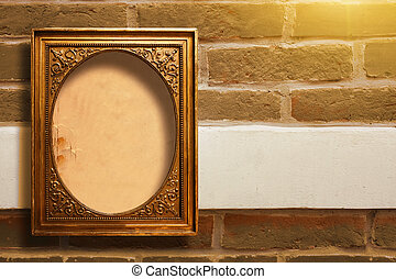 Gilded wooden frame for pictures on old brick wall - Gilded ...