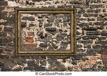 Gilded wooden frame over ruined brick wall