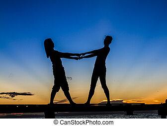 Gilrls standing on Bridge at Sunrise