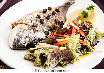 Gilt-head bream fish - Grilled gilt-head bream fish in herbs...