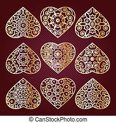 Gilt openwork hearts. Valentine's Day ornament for congratulations, cards, invitations, gifts.