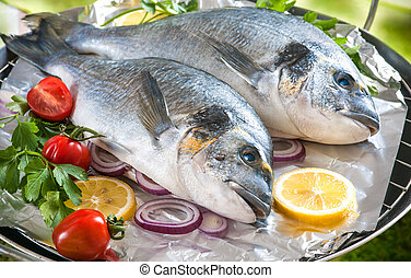 Gilthead sea breams on a grill - Some of Gilthead sea breams...