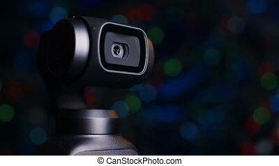 Gimbal camera on background bokeh - Gimbal compact camera...