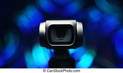 Gimbal camera on background bokeh - Gimbal compact camera...
